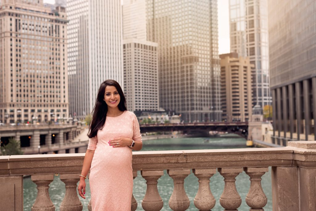 a pregnant woman at the Riverwalk in downtown Chicago by Mila Craila Photography