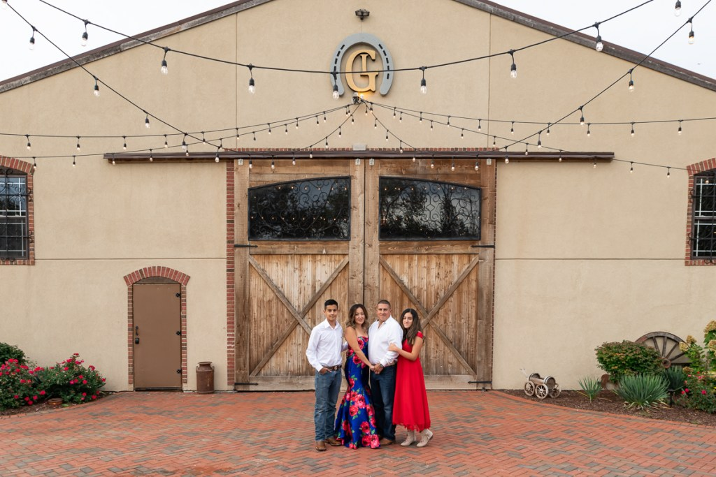 Family session for parents and teenage kids at Rancho Los Guzman in Joliet in the fall by family photographer Mila Craila Photography