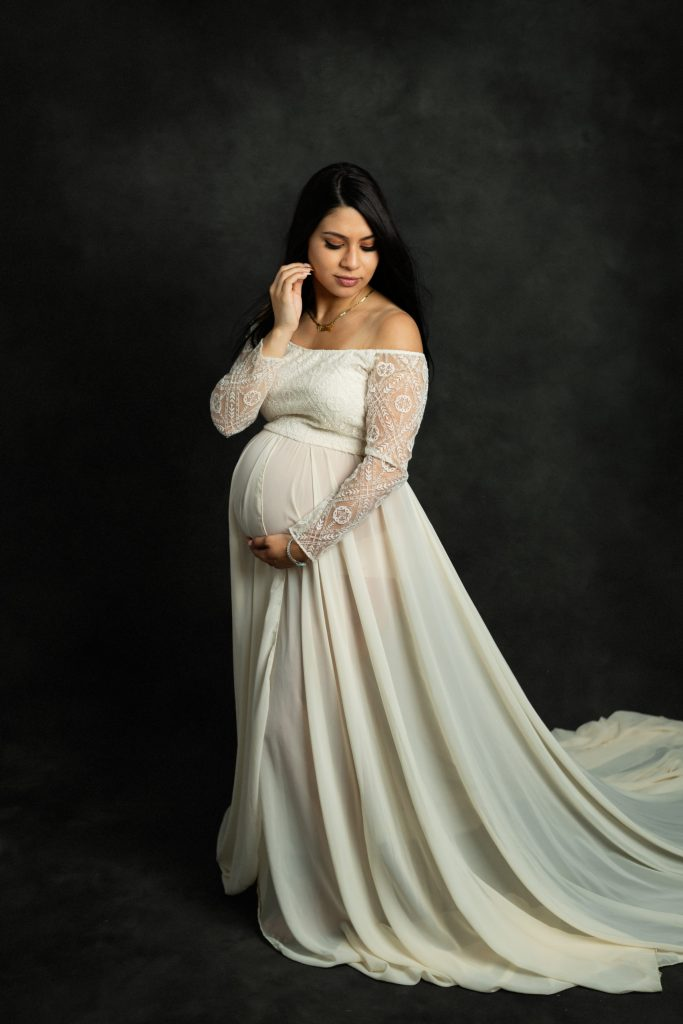 a pregnant woman in a photography studio by Mila Craila Photography