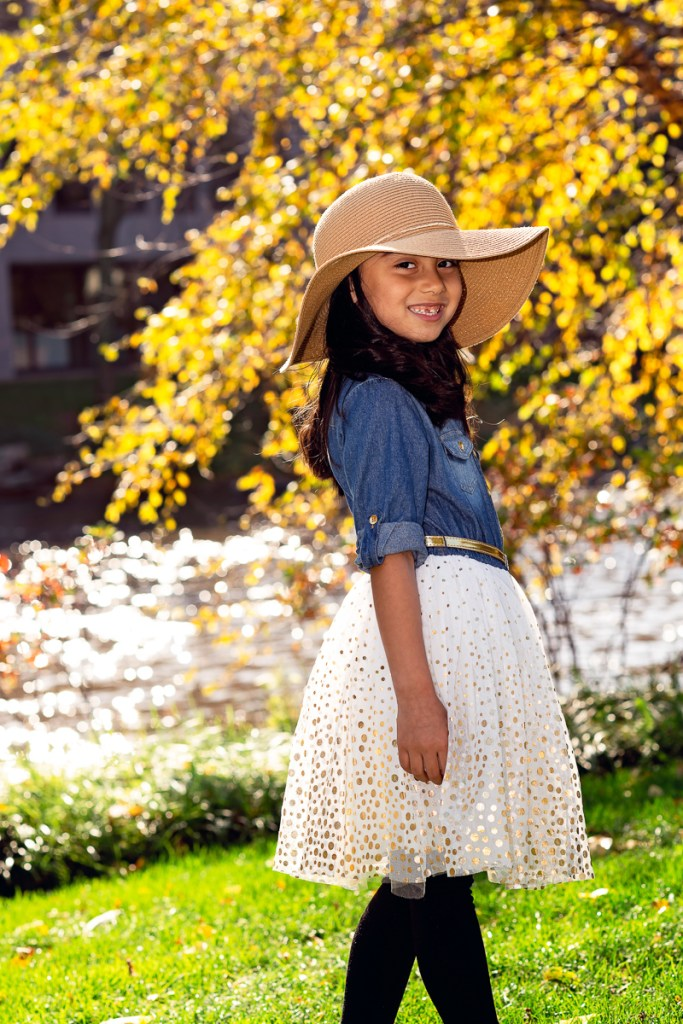 young girl on Naperville Riverwalk in the fall by family photographer Mila Craila Photography