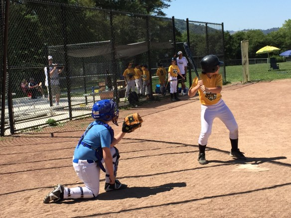 Comic kid sport moment: Tween couldn't get the catcher's helmet off without help from his coach - guess one size doesn't not quite fit all!