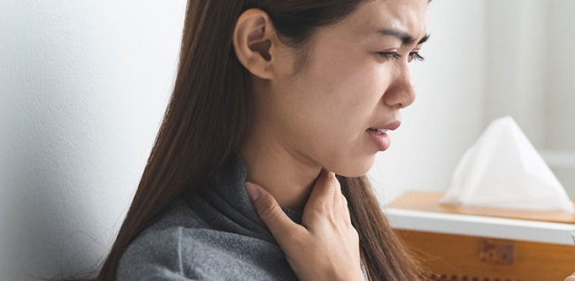 Woman with soar throat