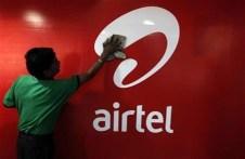A worker cleans a Bharti Airtel logo inside its shop in Kolkata February 2, 2011. REUTERS/Rupak De Chowdhuri