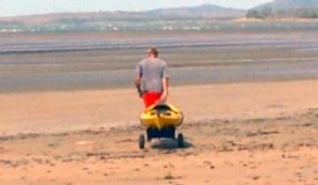 Pulling Kayak across mudflats