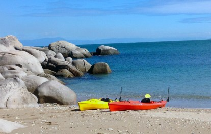 Beached kayaks at Lovers Bay