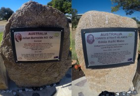Note little stone tributes at base of tribute momerial