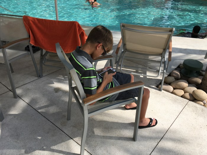 Phone time by the pool on vacation