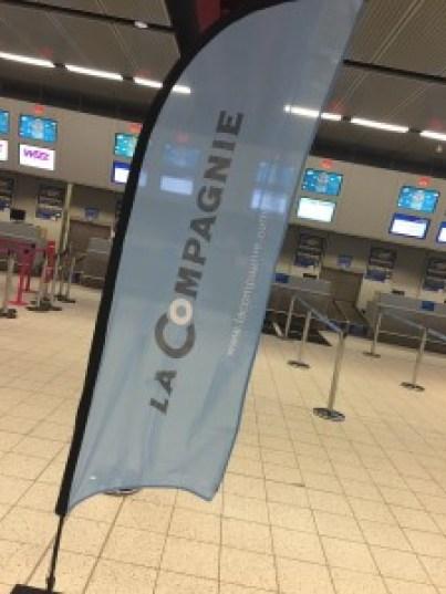 La Compagnie sign for check-in