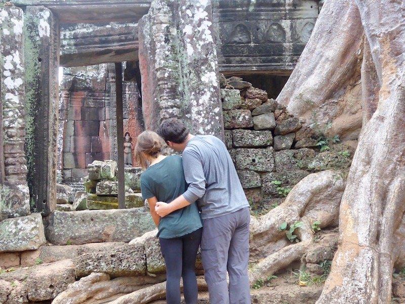 Couple looking into temple at Angkor Wat