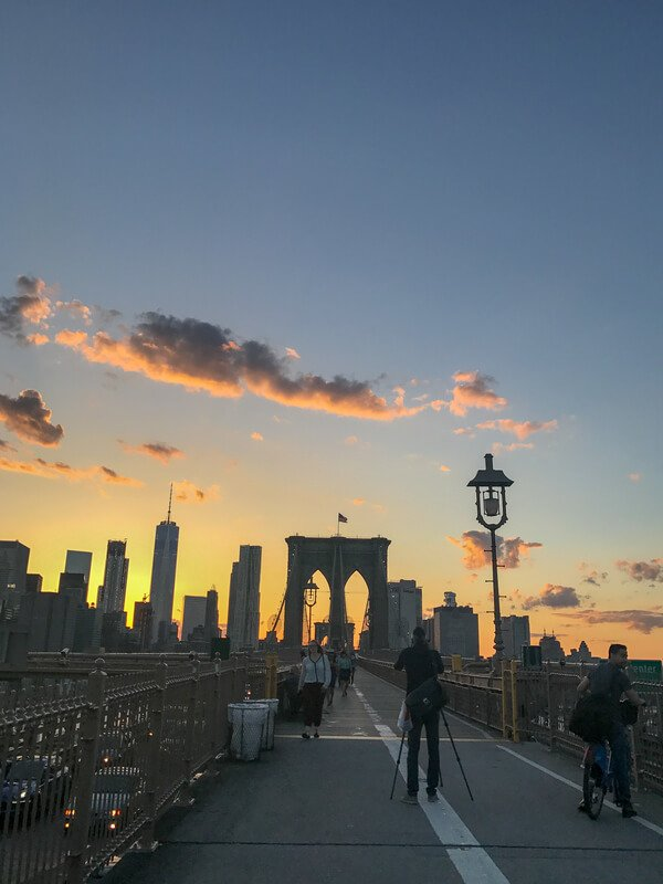 View of the Manhattan skyline at sunet from the Brooklyn Bridge