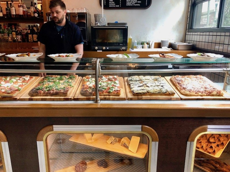 Pizza Counter with man in background