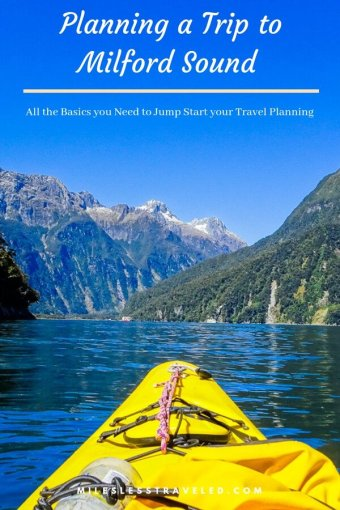 Planning a Trip to Milford Sound Kayak tip on water with mountains