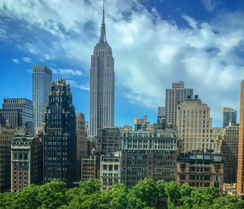 NYC skiline empire state building blue skies