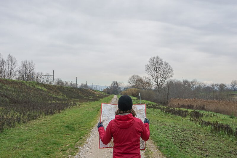 Holding a map up to read while walking on the Renaissance Trail Hike