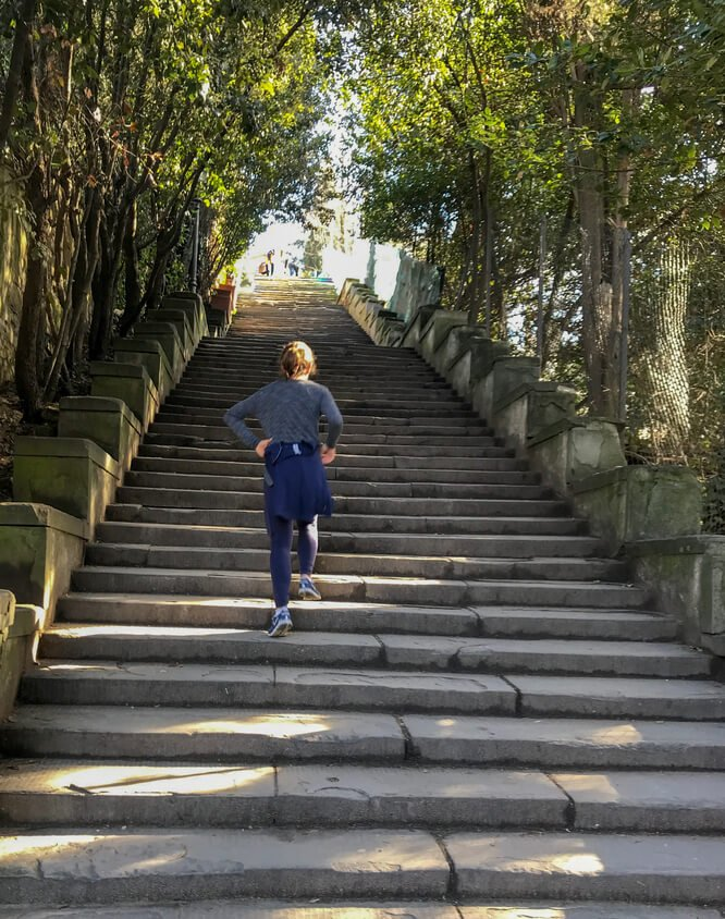 Running up the stairs to Piazza Michelangelo in Florence