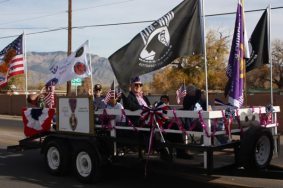 Float with POW photo in parade
