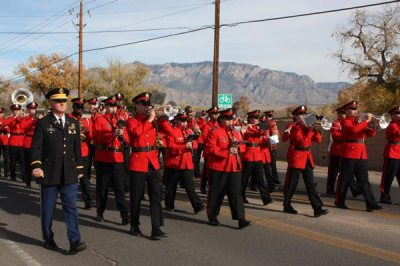 Marching band in red uniforms in parade