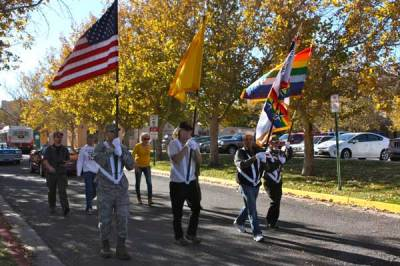 Marchers with flags in parade