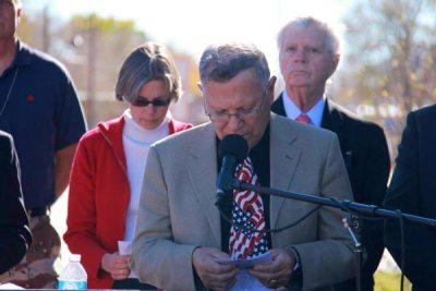 Man with patriotic tie speaking
