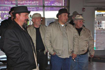 4 Men in coats and hats