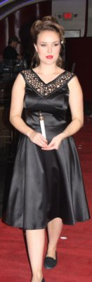 Model in black dress with candle