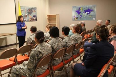 Women addressing audience of military members