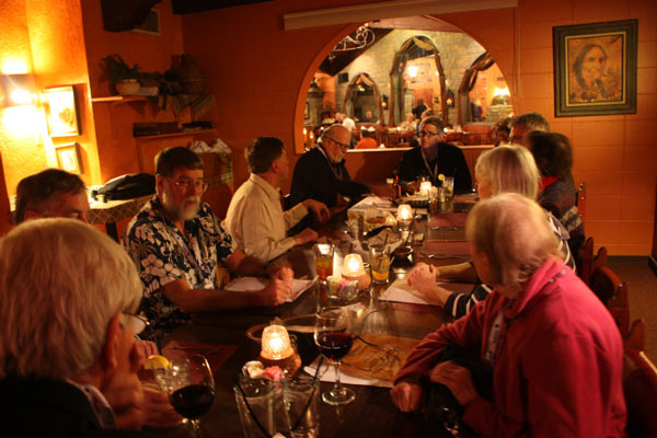 People sitting at table at Cervantes on Gibson was the host restaurant