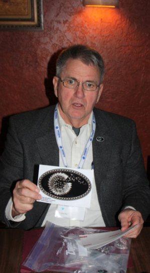 Bob Holliker shows his BratPin sticker (Stylized dandelion on black oval field)