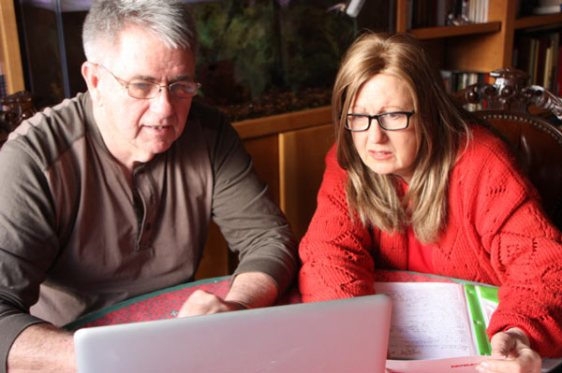 Two people looking at laptop screen