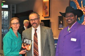 "Michael McNair from the Black Chamber of Commerce joins us for a photo with Circe holding book ""A Question of Color"""