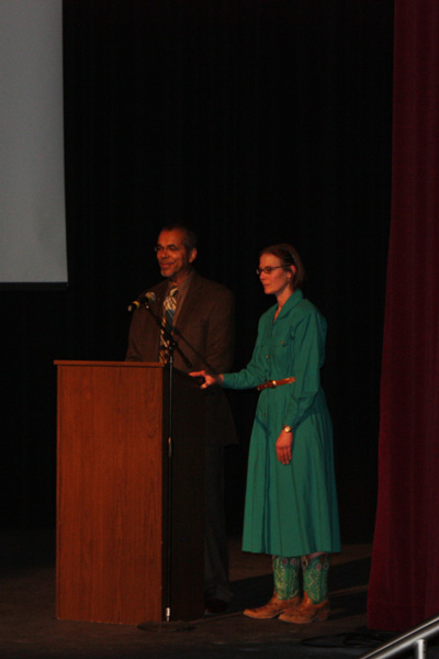 Peter and Circe open the film standing at the podium