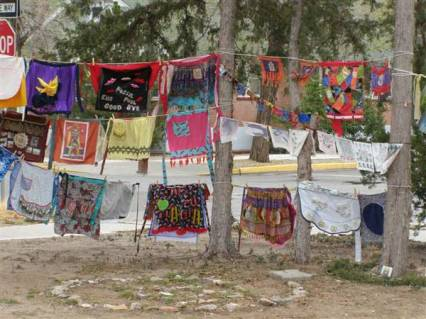 Aprons hanging on clotheslines between trees