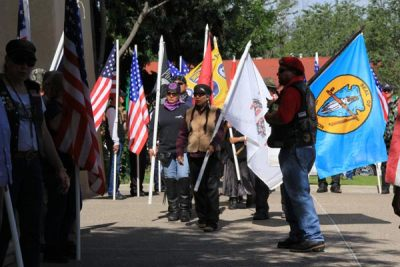 People holding US and organizational flags