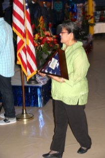 woman in green jacket with memorial flag