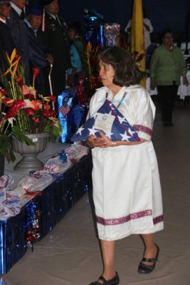 Woman in white dress with memorial flag