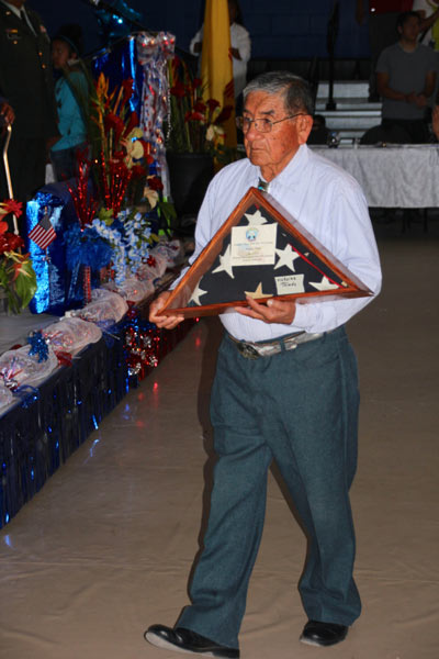 Man in blue shirt with memorial flag