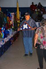 Man in striped shirt with memorial flag