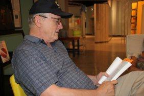 Profile man in service cap reading