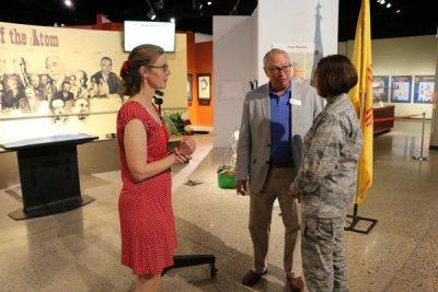 Circe Olson Woessner talking with people
