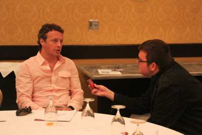 Ian, with microphone interviewing Jake Rademacher