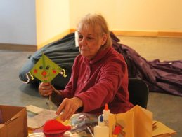 Joan Olson at craft table at Salute to Heroes Veterans Day Celebration 2014