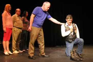 Telling Project cast man with hand on kneeling veteran