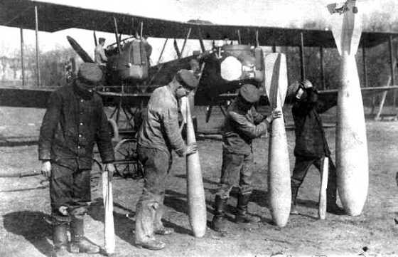 A German ground crew shows off an assortment of Gotha bombs. (Image source: WikiCommons)