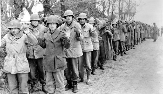 Thousands of American troops surrendered to the Germans during the 1944 Nazi Ardennes Offensive. How did Allied intelligence miss the signs that the Germans were planning to strike?