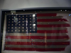 The Iwo Jima flag on display at the National Museum of the Marine Corps in Triangle, Virginia. Image courtesy WikiComons.