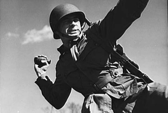 An American paratroops trains with a hand grenade.