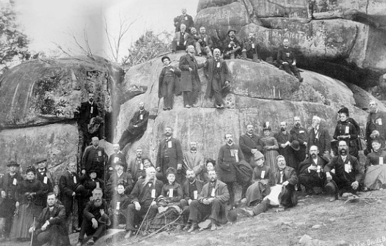 Union veterans from Rhode Island gather at Devil's Den. (Image source: Gettysburg.com)