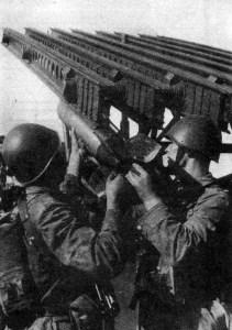 Soviet troops load a m-13 rocket into a Katyusha launcher.