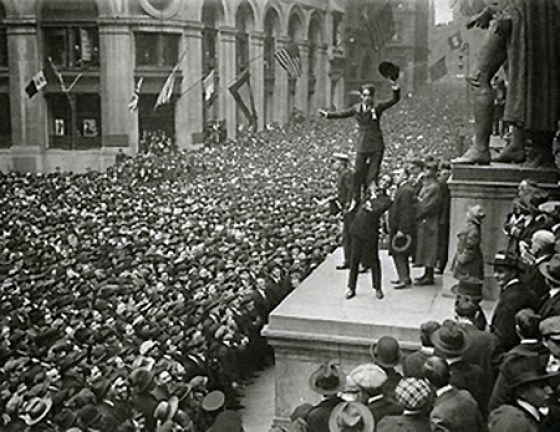 A Four-Minute Man delivers an address to a massive civilian crowd.