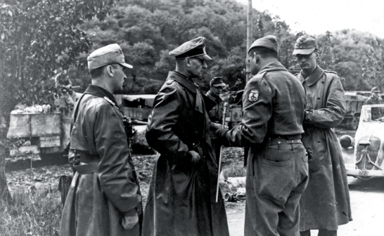 A German general surrenders to a member of the Brazilian Expeditionary Force. Italy, 1945.